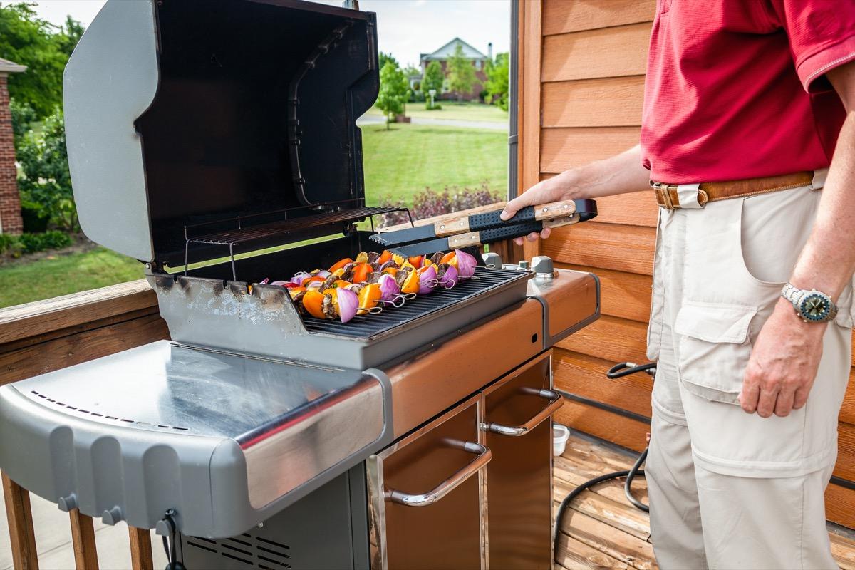 grill against deck railing