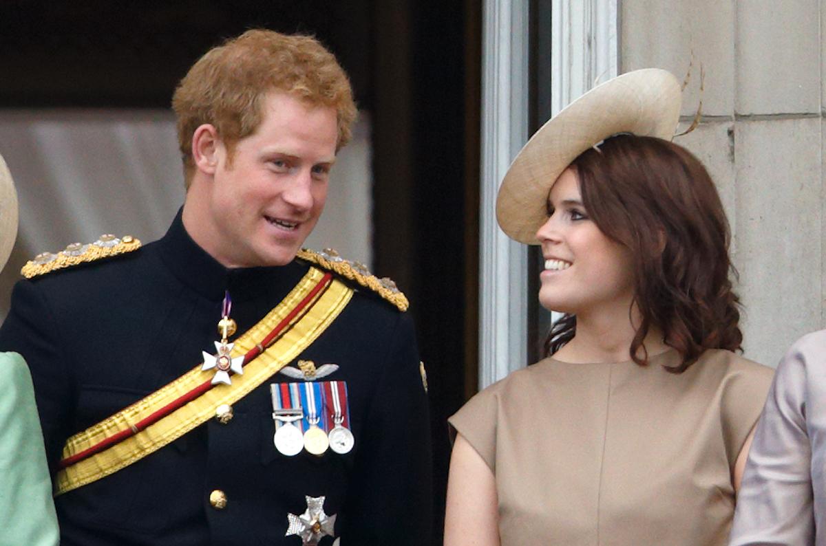 Prince Harry and Princess Eugenie stand on the balcony of Buckingham Palace