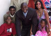 """Former Los Angeles Lakers' basketball star Earvin """"Magic"""" Johnson (C) poses with his family (clockwise from bottom L): son Earvin Jr., son Andre, wife Cookie, daughter Elisa, on his newly unveiled star on the Hollywood Walk of Fame in Los Angeles, 21 June 2001"""