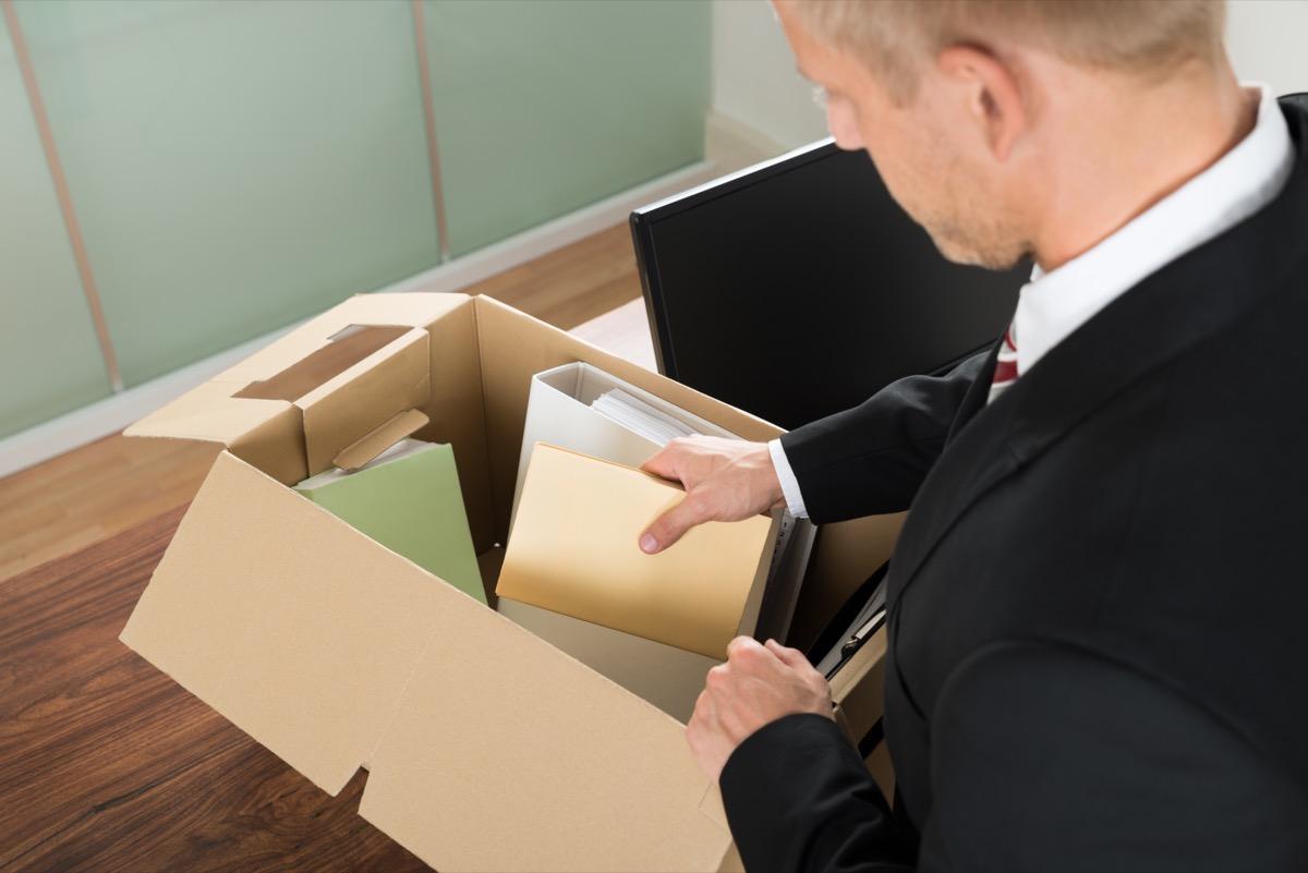 man packing box leaving job