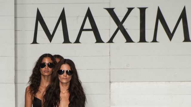 Models walk runway finale in designers swim apparel during the Maxim fashion show