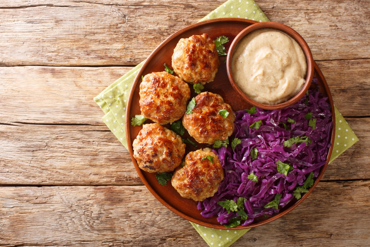 meatballs, purple cabbage, and sauce on plate