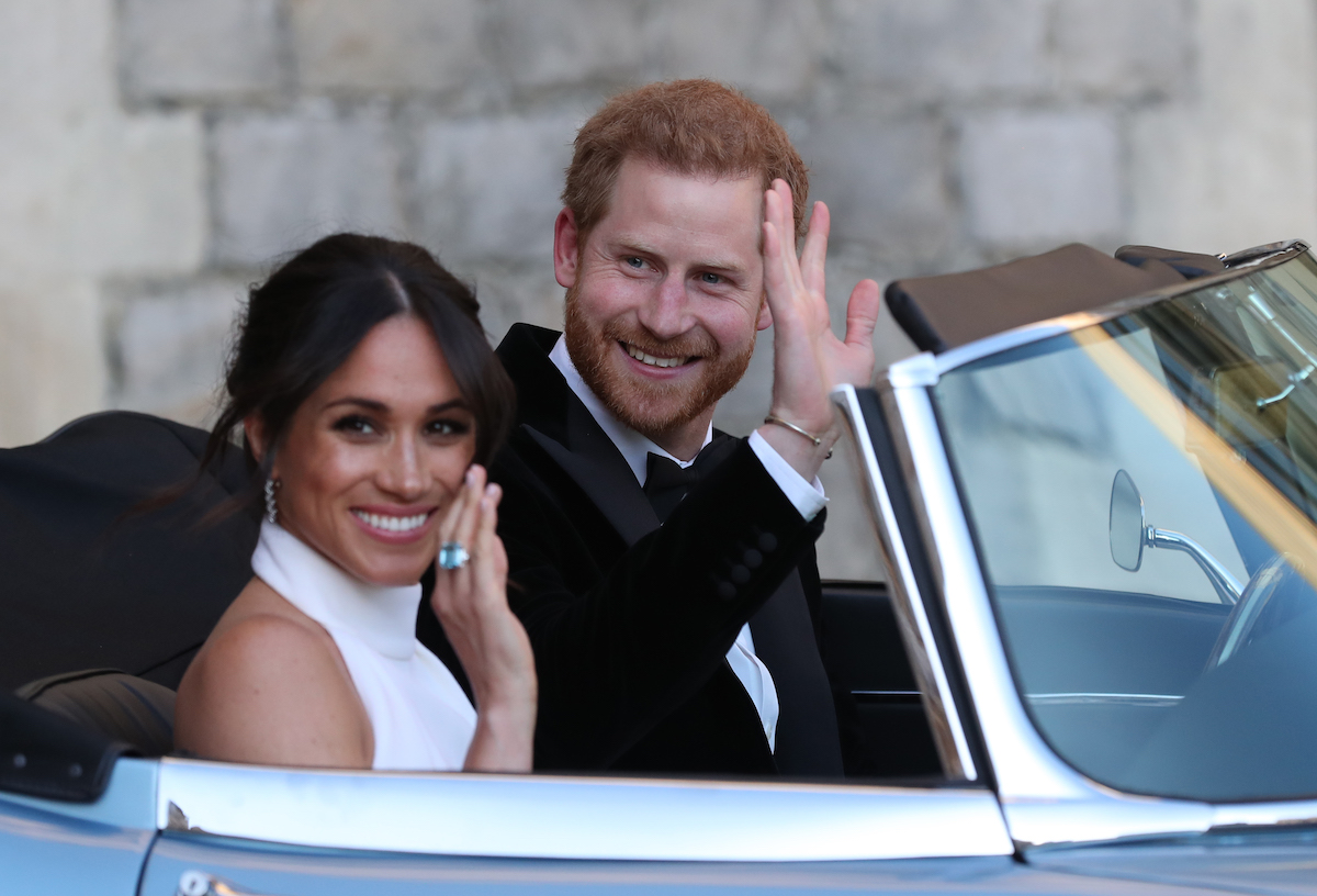 Britain's Prince Harry, Duke of Sussex, and Meghan Markle, Duchess of Sussex, leave Windsor Castle in Windsor on May 19, 2018