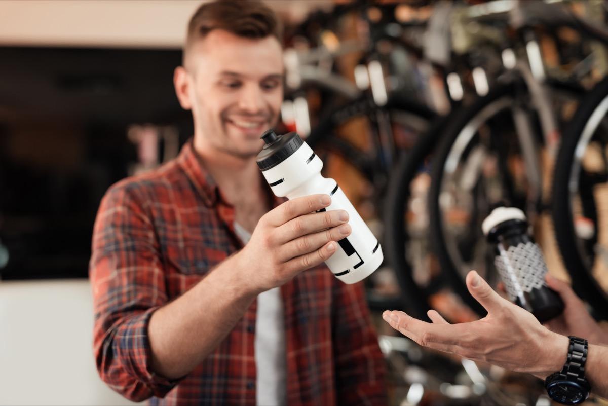 men shopping for water bottles