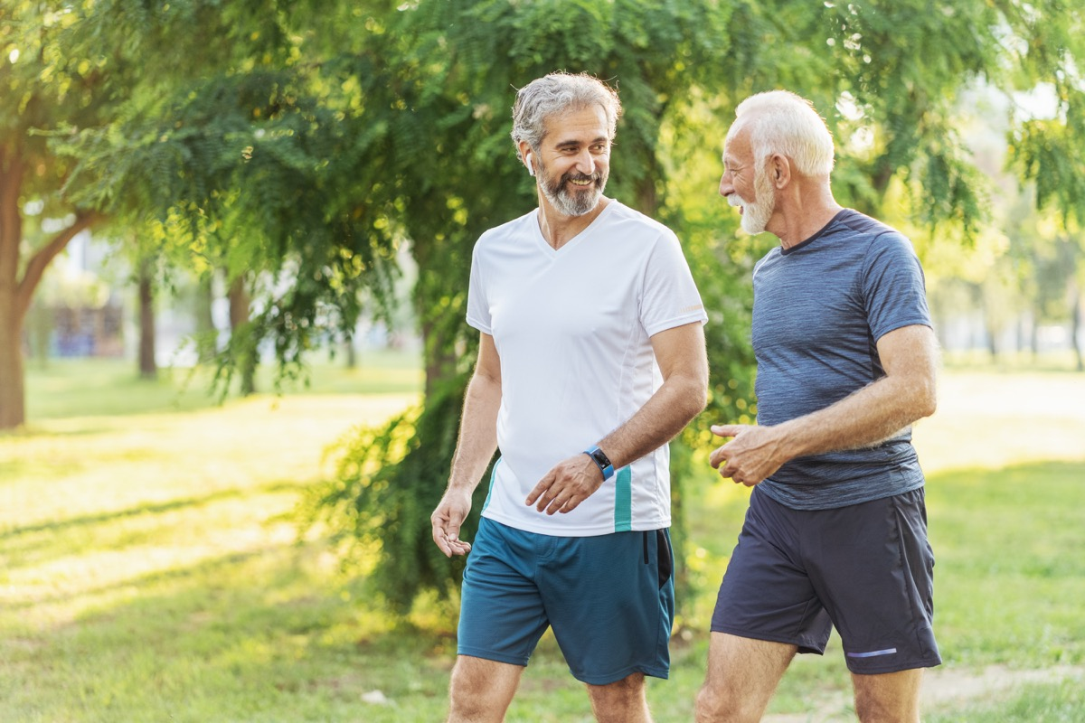 Two Senior male athletes jogging in the park