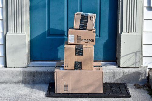 multiple amazon boxes on a doorstep
