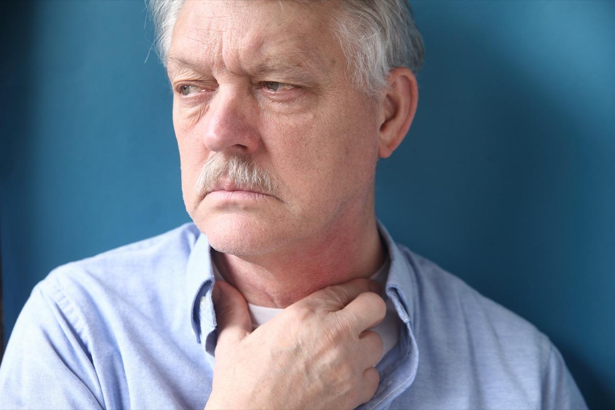 Man having trouble swallowing