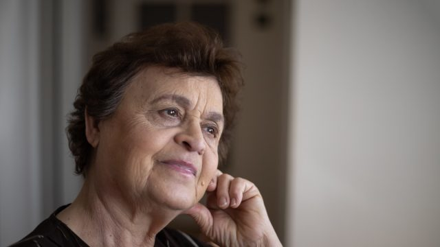 Portrait of an senior woman, Very old grandmother looking in the direction of the window