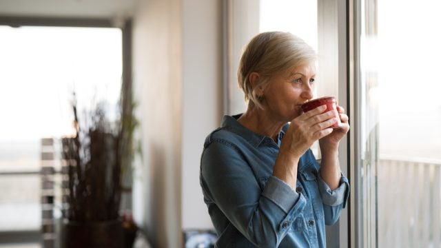 Older woman drinking coffee