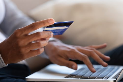 hold bank credit card and type on laptop, shopping online