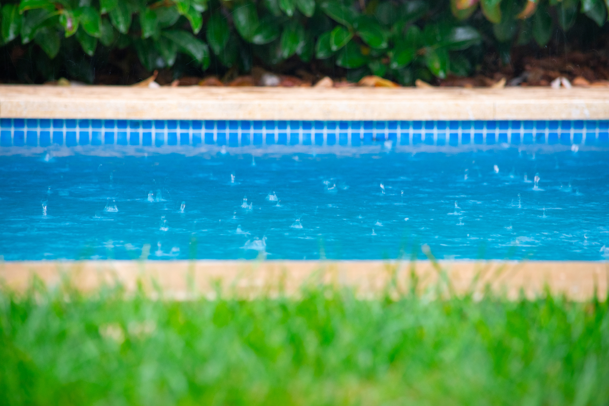Close up of rain drops falling in the swimming pool