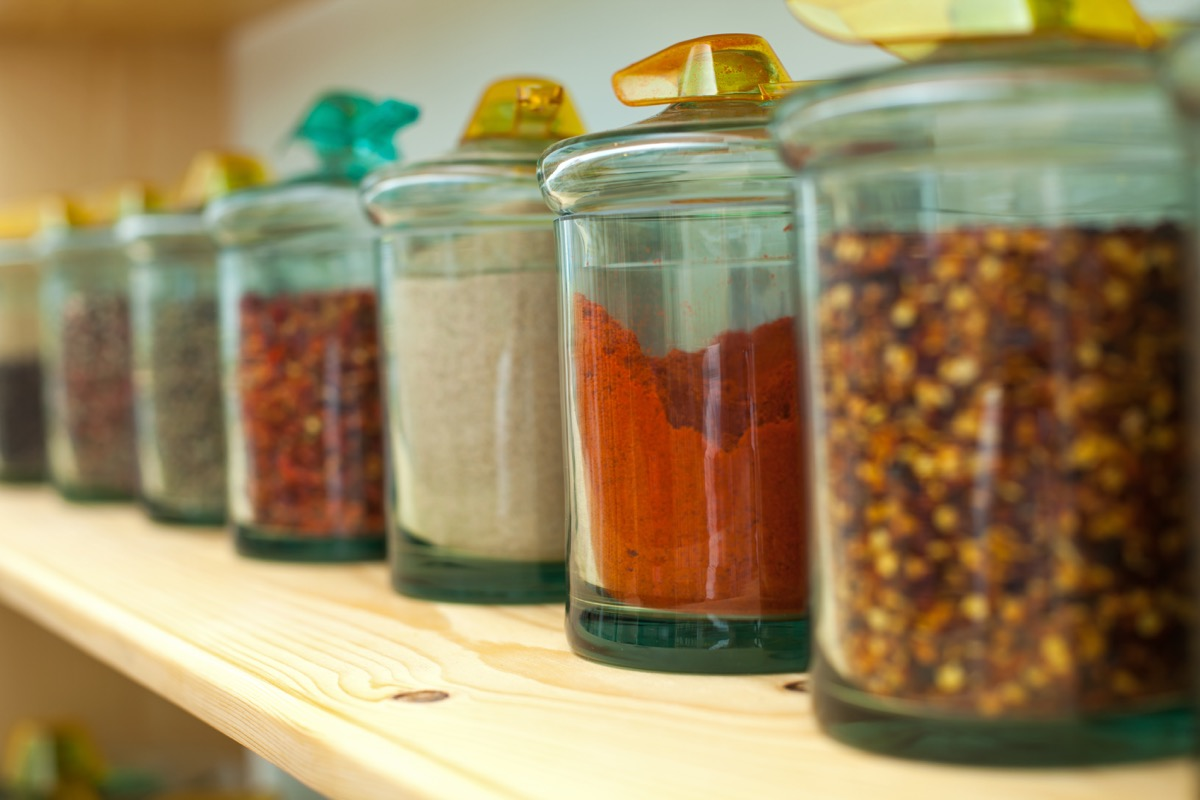 red spices in a cabinet