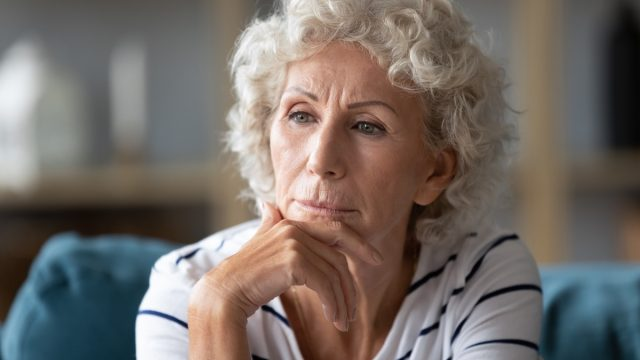 Serious older woman thinking