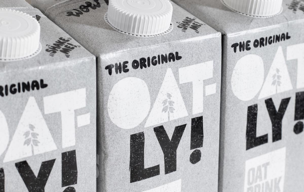London UK - March 8th 2021 - Oatly milk cartons macro closeup. Oatly is a dairy free vegan milk alternative.
