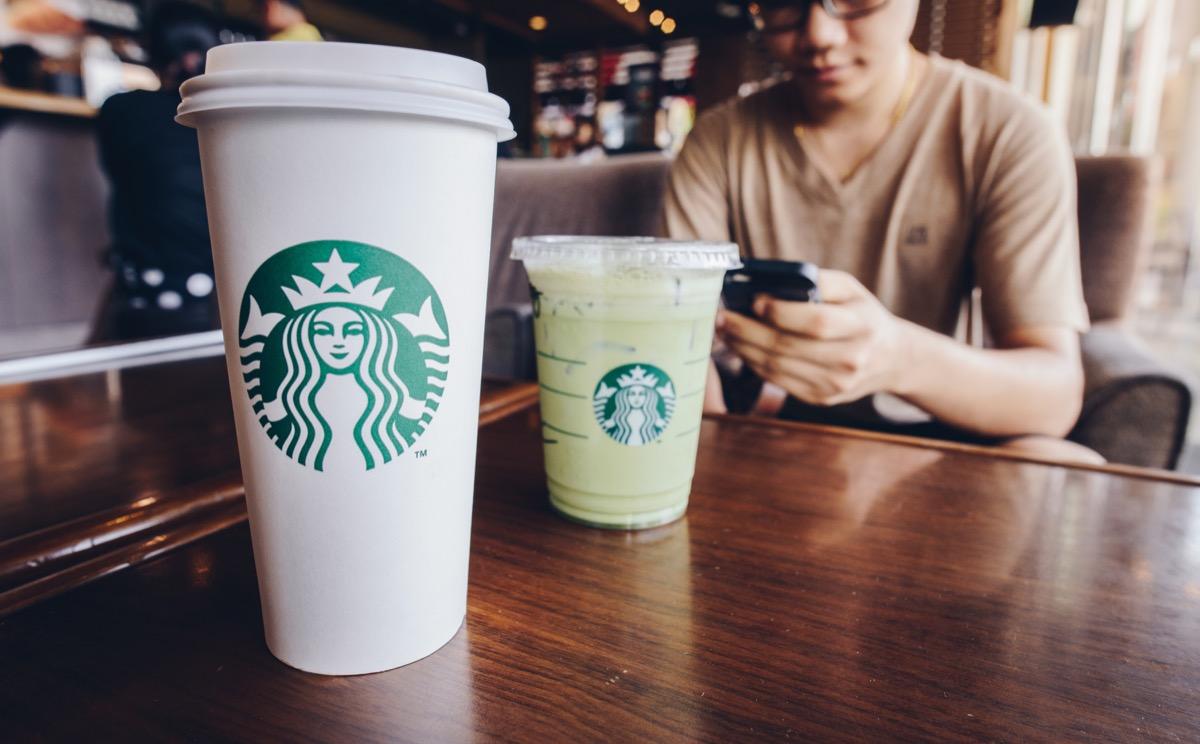 A Venti size of Starbucks coffee with Grande size of Ice green tea latte in Starbucks coffee shop.