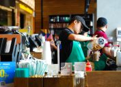 SEREMBAN,MALAYSIA - SEPTEMBER 18, 201T: Worker at Starbucks Cafe preparing coffee for customers.Starbucks is an American global coffee company and coffeehouse chain based in Seattle, Washington