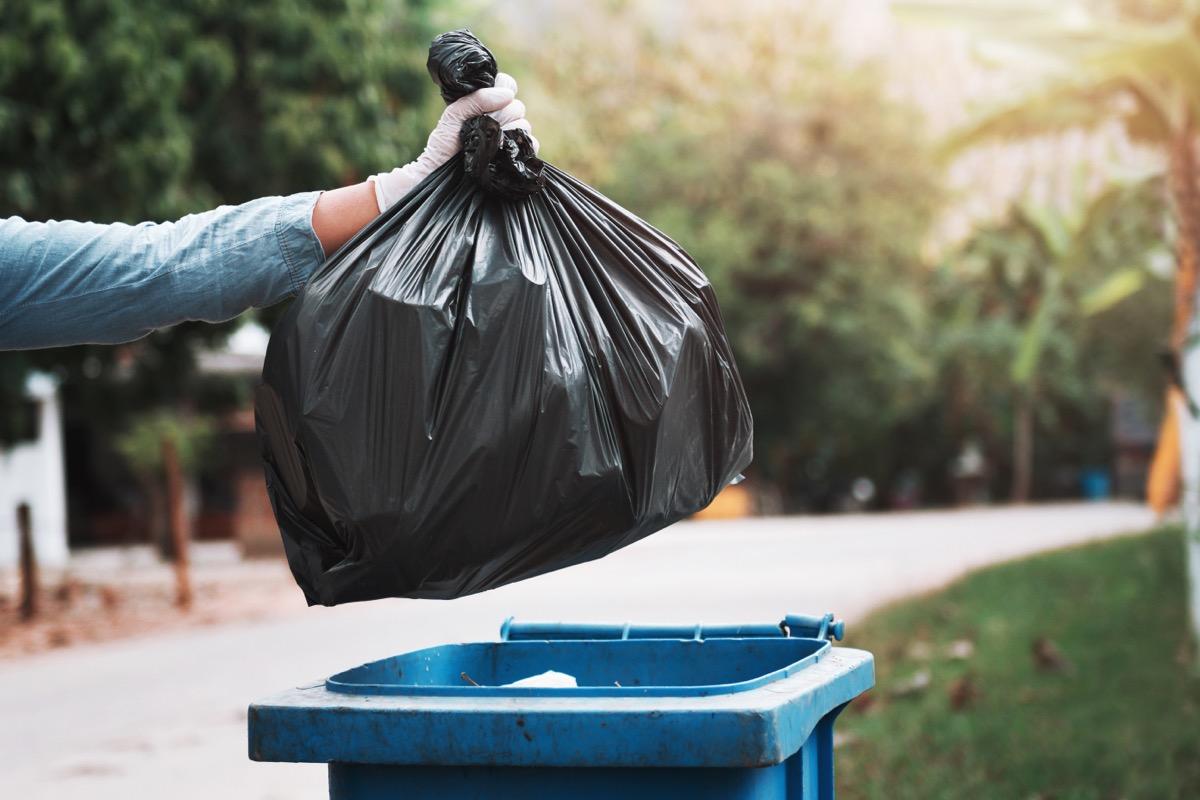 gloved-hand-throwing-away-trash