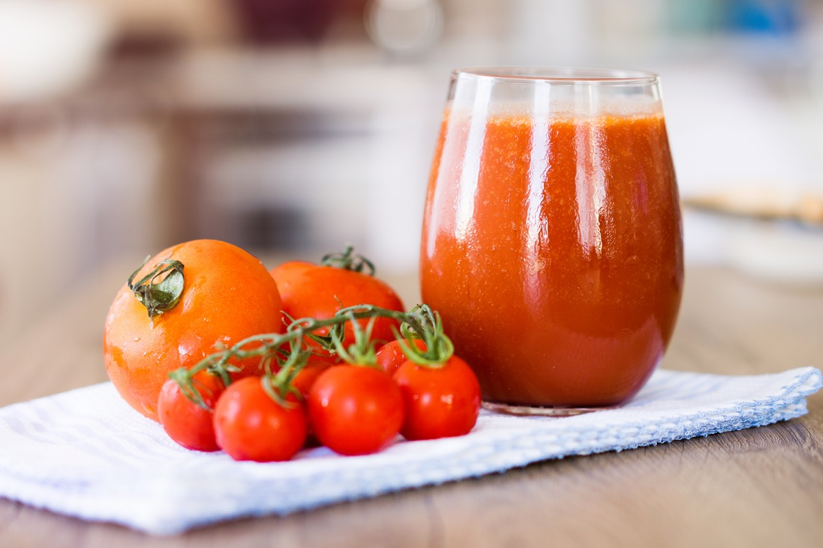 Tomato Juice on scarf over table