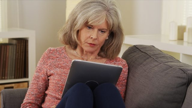 Older woman on a tablet