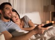 Couple watching TV before bed
