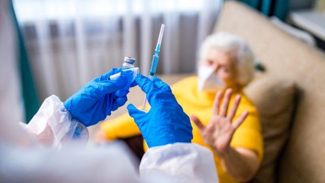 woman refusing vaccination