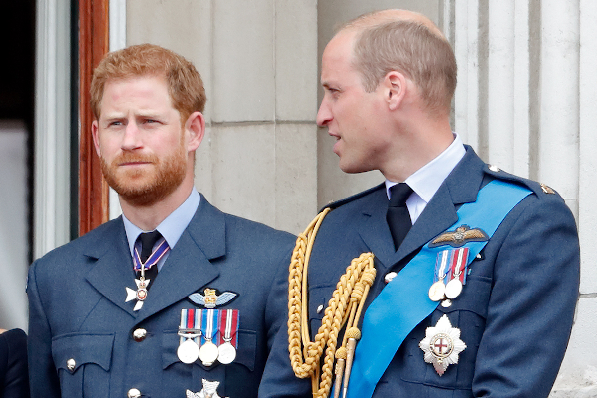 Prince Harry, Duke of Sussex and Prince William, Duke of Cambridge watch a flypast to mark the centenary of the Royal Air Force from the balcony of Buckingham Palace on July 10, 2018 in London, England.