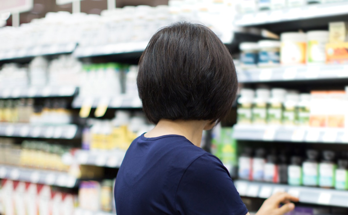 woman shopping for supplements at store