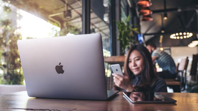 Woman using apple products magnet warning
