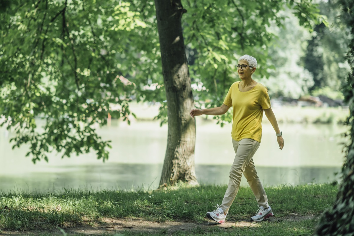Mature Woman Enjoying Walking Exercise by the Lake