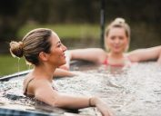 two blonde women using hot tub