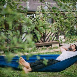 Man on a hammock in the backyard