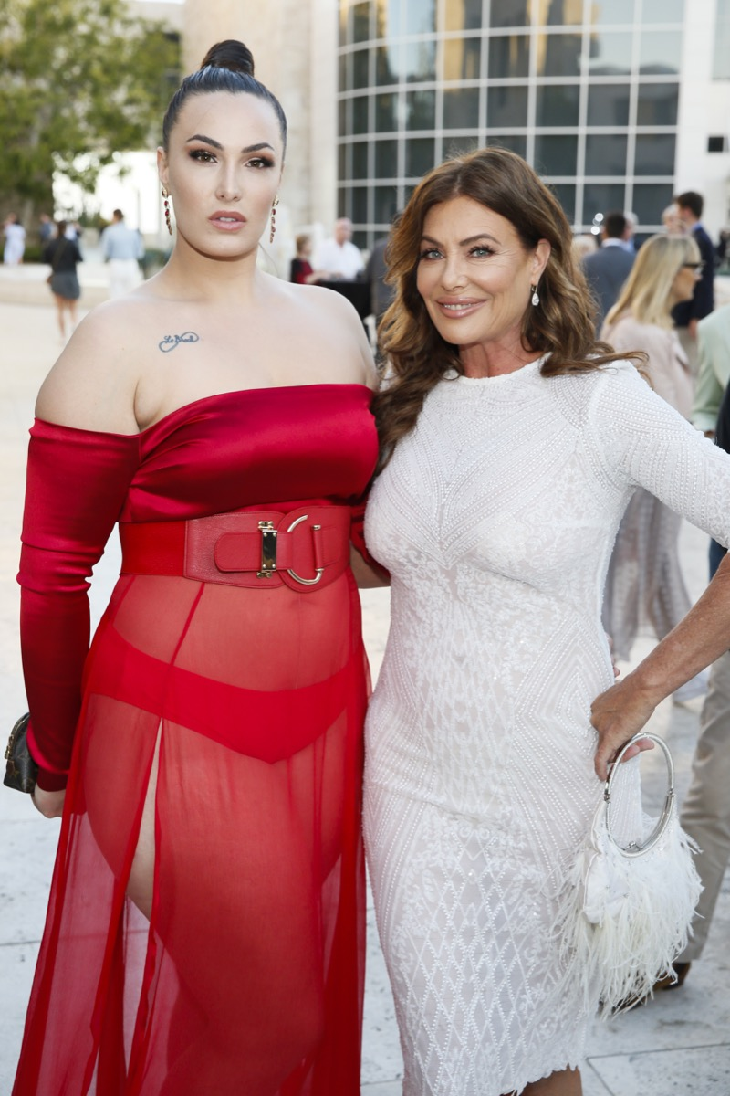 Arissa and Kelly LeBrock in red dress white dress