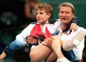 Bela Karolyi carrying Kerri Strug at the 1996 Olympics