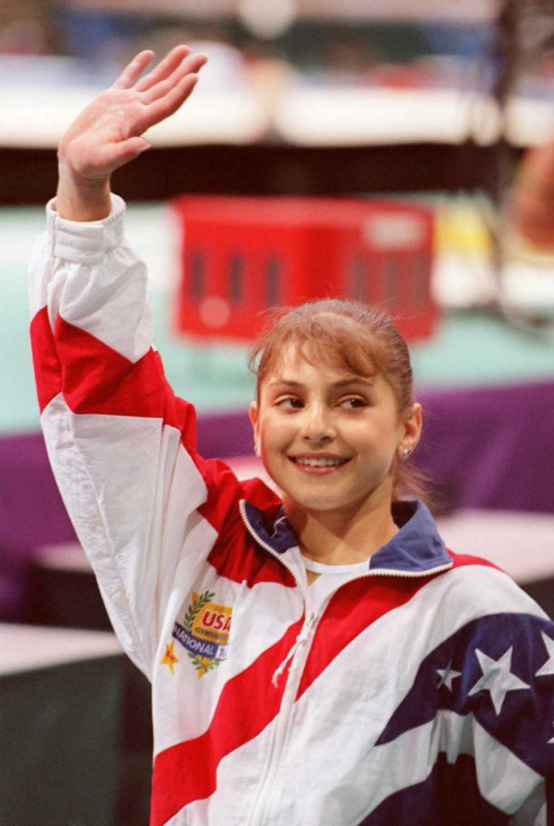 Dominique Moceanu waving to fans at the 1996 Olympics