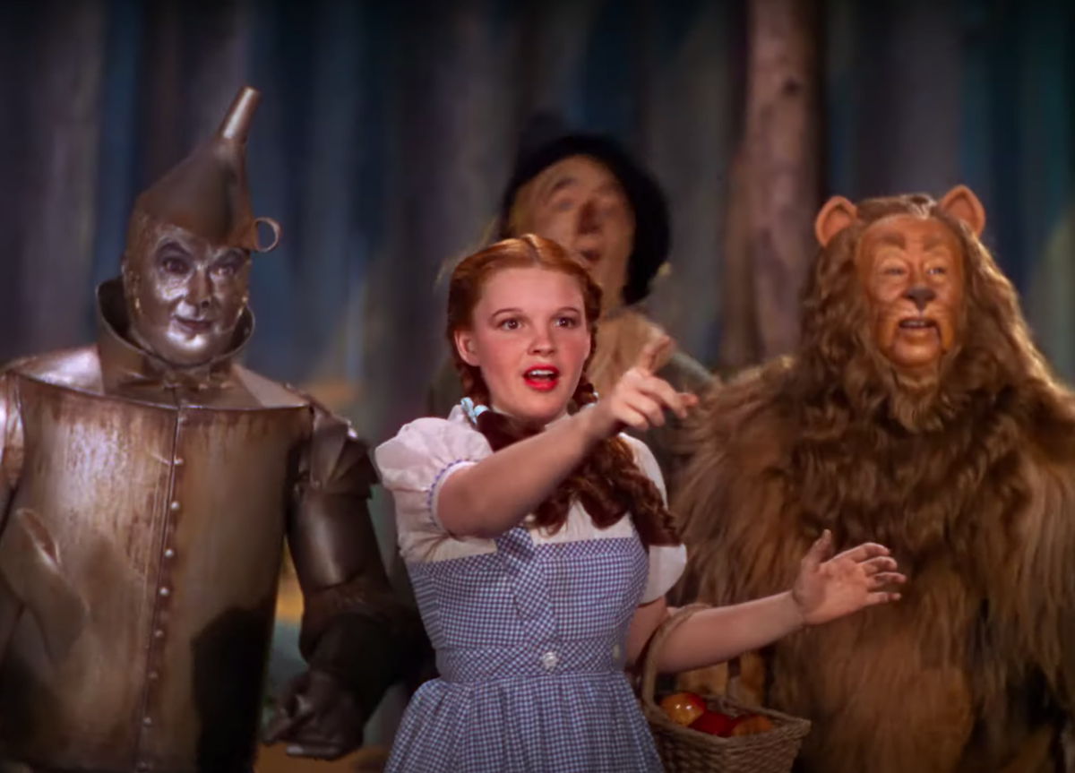 """The Tin Man, Dorothy, the Scarecrow, and the Cowardly Lion in """"The Wizard of Oz"""""""
