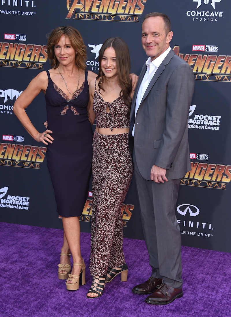 """Jennifer Grey, Stella Gregg, and Clark Gregg at the premiere of """"Avengers: Infinity War"""" in 2018"""