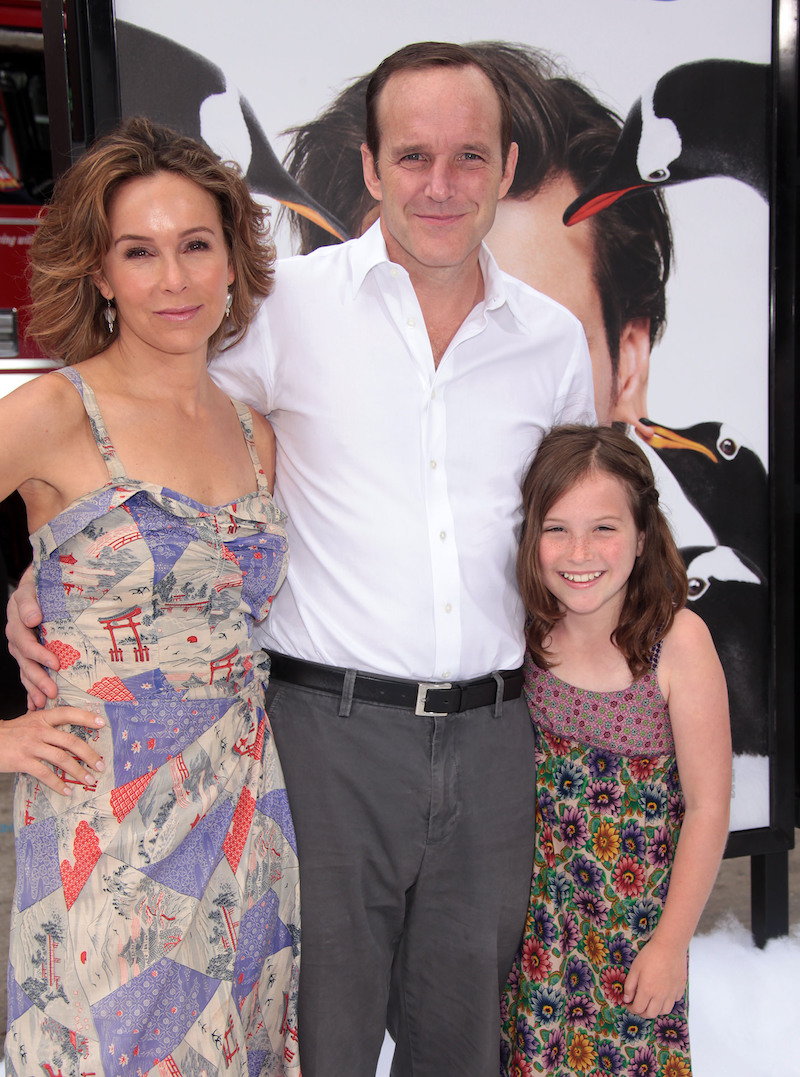 """Jennifer Grey, Clark Gregg, and daughter Stella at the premiere of """"Mr. Popper's Penguins"""" in 2011"""