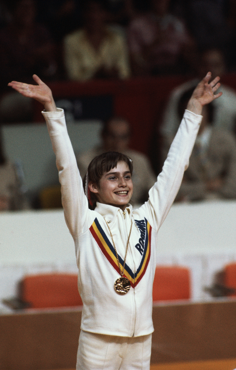 Nadia Comăneci with one of her gold medals at the 1976 Olympics