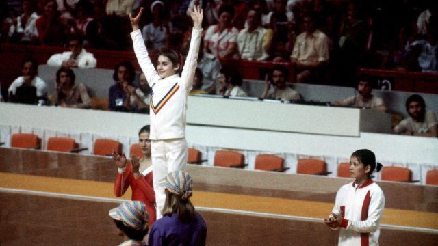 Nadia Comăneci on the medal podium at the 1976 Olympics