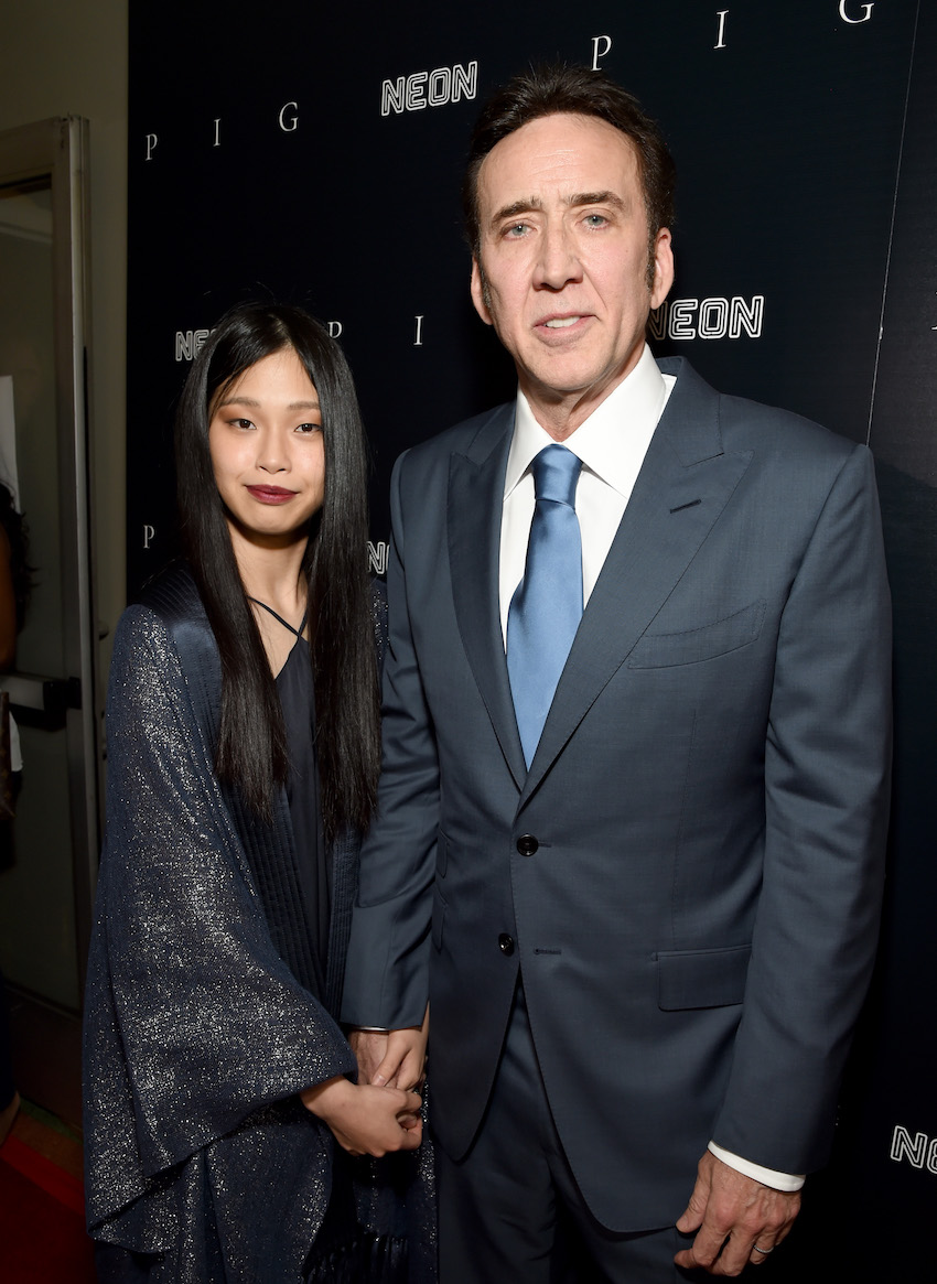 """Riko Shibata and Nicolas Cage at the premiere of """"Pig"""" in July 2021"""