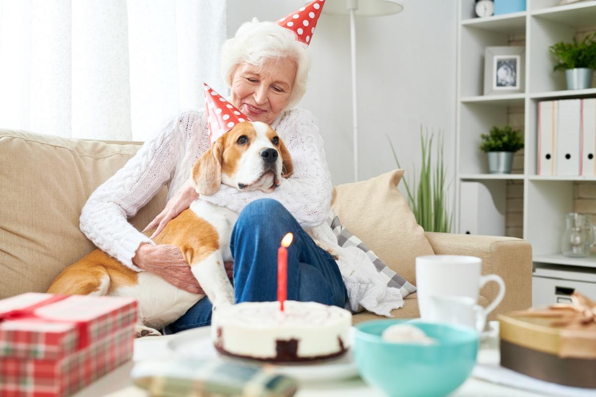 Senior woman and dog celebrating birthday