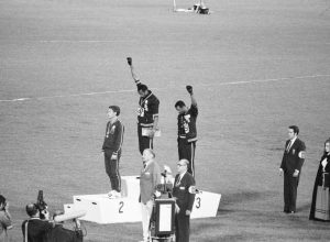 Tommie Smith, John Carlos, and Peter Norman on the medal podium at the 1968 Olympics