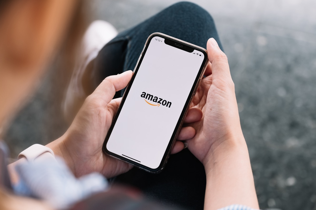 person using amazon app on smartphone