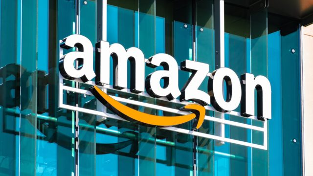 An Amazon logo sign hanging in front of a building