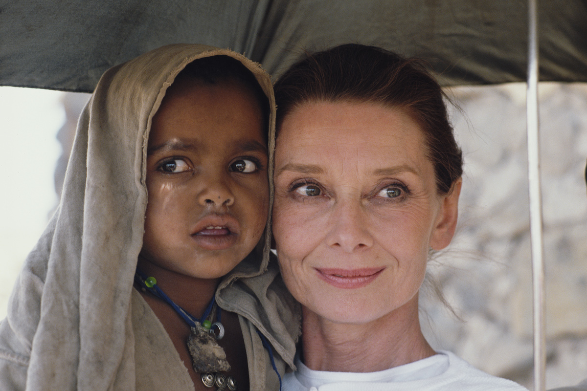 Actor and humanitarian Audrey Hepburn with an Ethiopian girl on her first field mission for UNICEF in Ethiopia, 16th-17th March 1988.