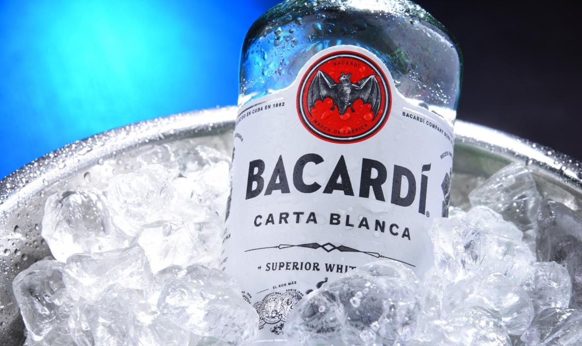 Bottle of bacardi in a bucket of ice