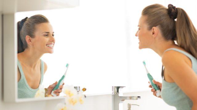 Woman done brushing her teeth