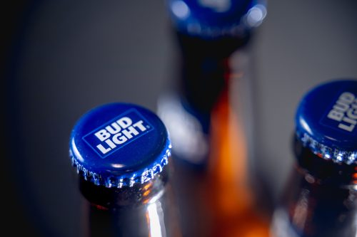 Closeup cap of bottles Bud Light beer. Bud Light was introduced in 1982 by Anheuser-Bucsh InBev., the top selling beer in the United States