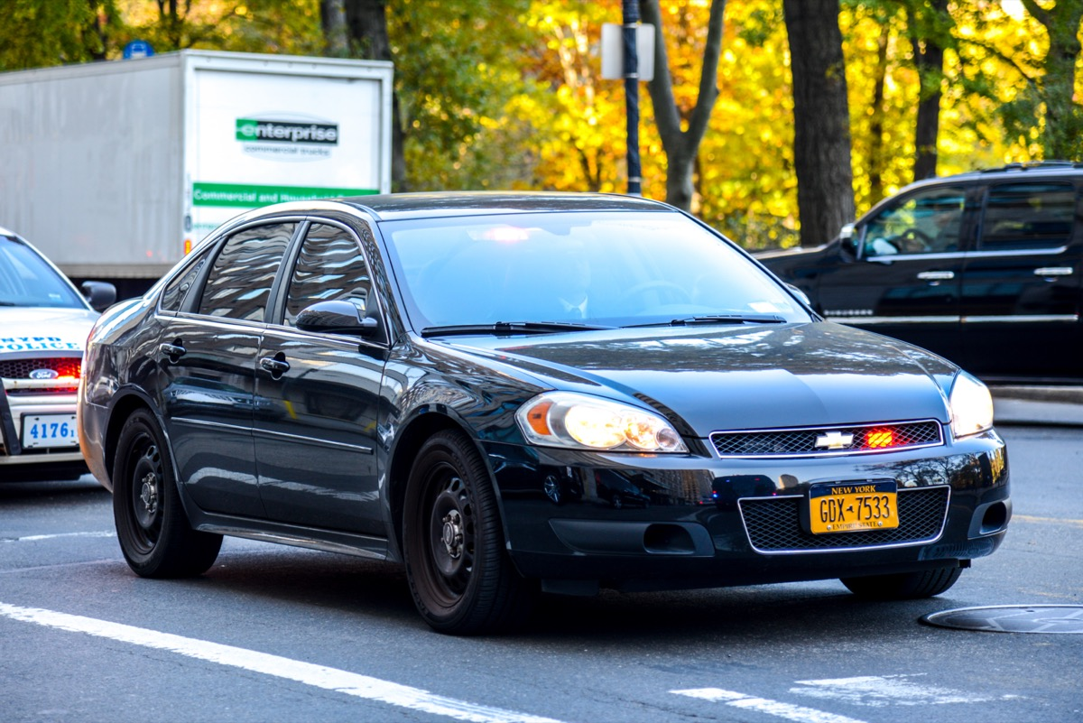A black Chevrolet Impala on the street