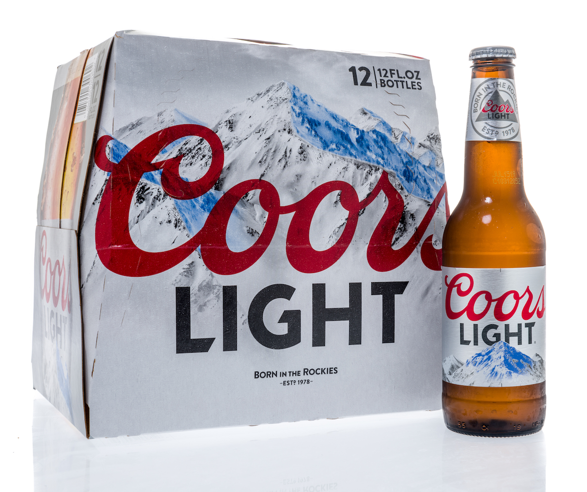 A twelve pack of Coors Light beer bottles on an isolated background.